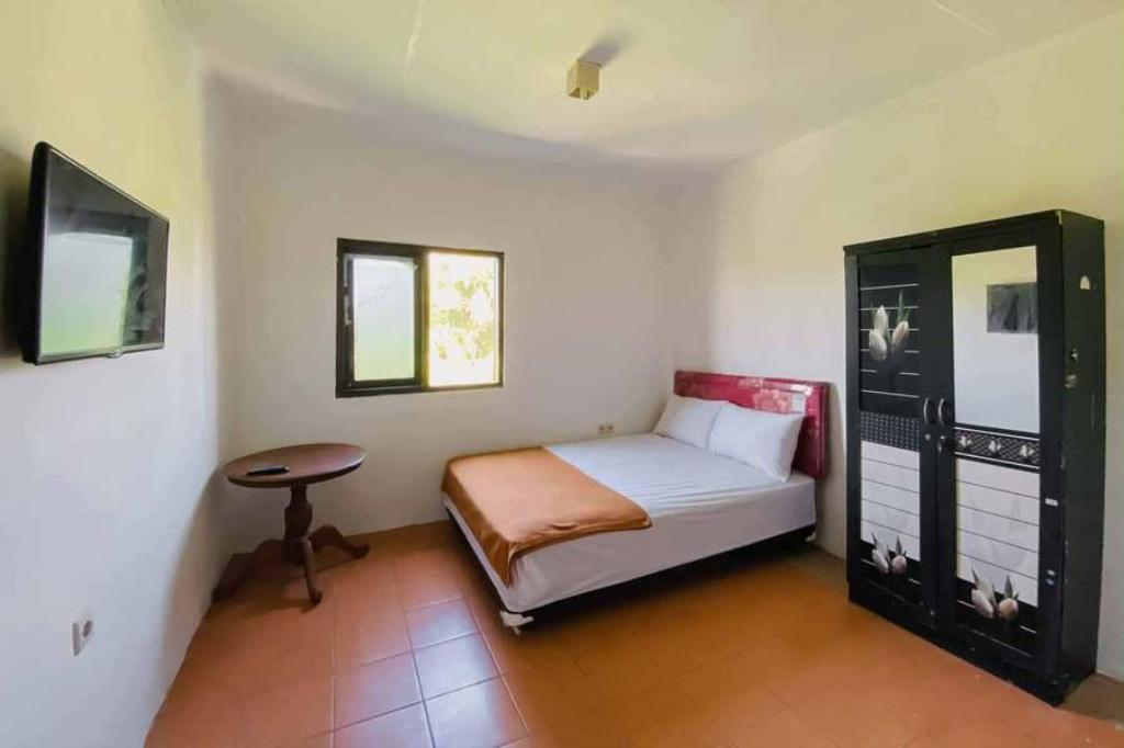 Kamar penginapan di Kanca Homestay