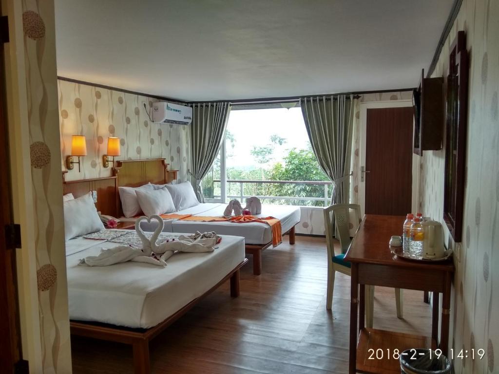 Fasilitas kamar Royal Caravan Hotel & Outbond
