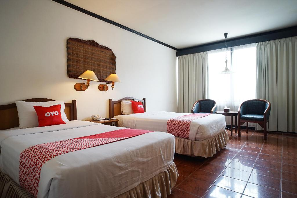 Fasilitas kamar Capital O 1735 Adika Bahtera Hotel